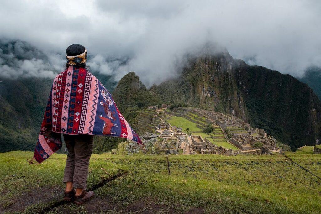 A woman looking at Machu Picchu